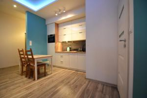 Kuchnia lub aneks kuchenny w obiekcie MNE Apartament