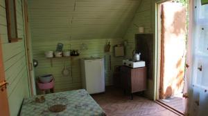 Кухня или мини-кухня в База отдыха Рассвет на Оке