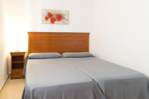 A bed or beds in a room at Gemelos 4 - Beninter