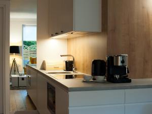 Kuchnia lub aneks kuchenny w obiekcie Apartamenty Amko Style Barrakuda Wiila Nord
