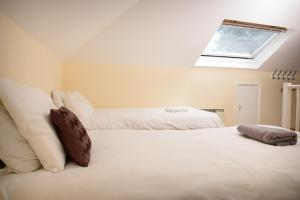 A bed or beds in a room at Mayview Guest House