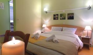 A bed or beds in a room at VVF Villages « Les Sources de la Loire » Les Estables