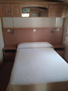 A bed or beds in a room at Camping Fuentes Blancas