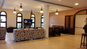 Uma área de estar em Hotel das Figueiras