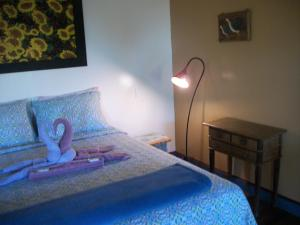 A bed or beds in a room at Chales das Andorinhas