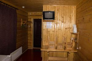 A television and/or entertainment centre at Yut Camping