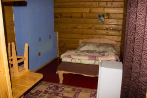 A bed or beds in a room at Yut Camping
