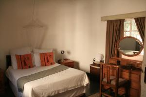A bed or beds in a room at Gweta Lodge