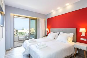 A bed or beds in a room at Menta City Boutique Hotel