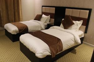 Cama ou camas em um quarto em Awrad Royal
