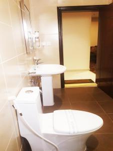 Um banheiro em Procare Apart hotel