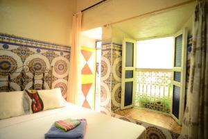 Ein Bett oder Betten in einem Zimmer der Unterkunft Riad Espagne
