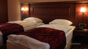 Posteľ alebo postele v izbe v ubytovaní Artemis Resort Wellness Hotel