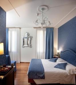 Cama ou camas em um quarto em Hotel Ca' D'Oro