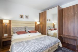 A bed or beds in a room at Residence Villa Karda
