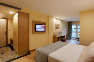 A television and/or entertainment center at Windsor Copa Hotel
