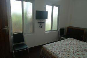 Télévision ou salle de divertissement dans l'établissement Hilltop Lodge