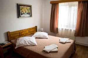 Un pat sau paturi într-o cameră la Casa Diana