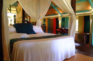 A bed or beds in a room at Bon Ton Antique Wooden Villas