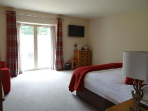 A bed or beds in a room at The Honingham Buck