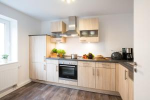 A kitchen or kitchenette at Boardinghouse Living28 Aachen