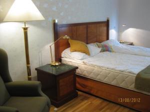Vuode tai vuoteita majoituspaikassa Lakefinland Guesthouse