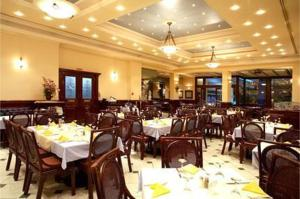 A restaurant or other place to eat at Palladion Hotel