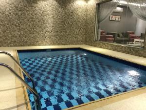 المسبح في منتجع الوسام جاردن للنزل السياحية أو بالجوار