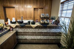 A kitchen or kitchenette at Marv Herzog Hotel