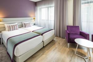 A bed or beds in a room at Empire Lisbon Hotel