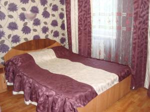 Кровать или кровати в номере Отель Акрополь