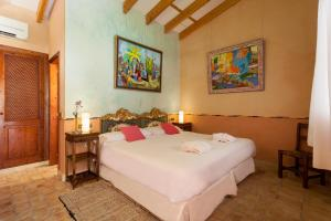 A bed or beds in a room at Es Revellar Art Resort - Adults Only