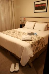 A bed or beds in a room at Blue Tree Towers Saint Michel