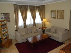 A seating area at Hotel Jardim