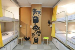 A bunk bed or bunk beds in a room at The River Hostel