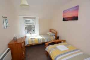 A bed or beds in a room at St Magnus Self Catering Lerwick