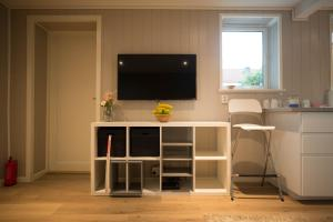 A television and/or entertainment center at Apartment at Ranheim
