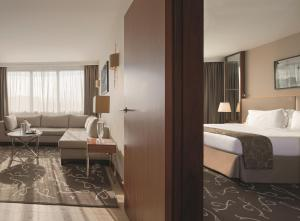 A bed or beds in a room at Crowne Plaza Paris - Neuilly, an IHG Hotel