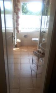 Ein Badezimmer in der Unterkunft Harz Resort Waldesruh