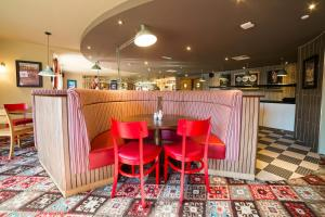 The lounge or bar area at Red Squirrel, Stevenston by Marston's Inns