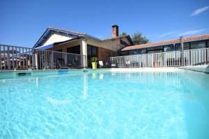The swimming pool at or near Kyriad Prestige Bordeaux Aeroport