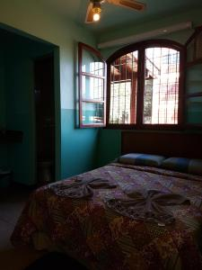 A bed or beds in a room at Hostel Iguazu Falls