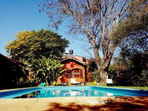 The swimming pool at or near Hostel Iguazu Falls
