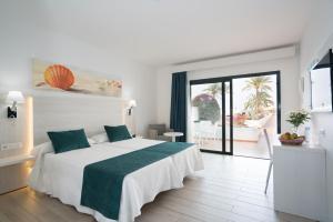 Cama o camas de una habitación en Hotel THB Flora