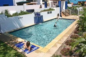 A view of the pool at Coral Sands by Kacys or nearby