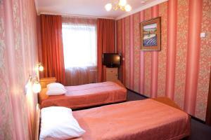 Кровать или кровати в номере Отель Чита