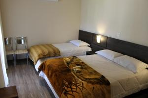 A bed or beds in a room at Residencial Aconchego do Lago