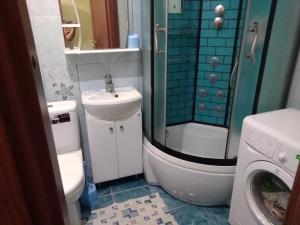 Ванная комната в Апартаменты в центре у моря