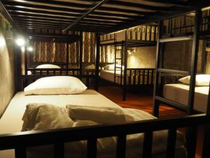 A bunk bed or bunk beds in a room at Playground Hostel