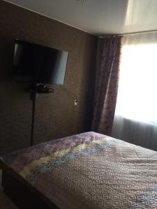 Кровать или кровати в номере Уютные 1-комнатные апартаменты